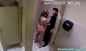 Housewife large facial in restaurant restroom